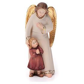 Angelo custode con bambina stile moderno legno Val Gardena s1