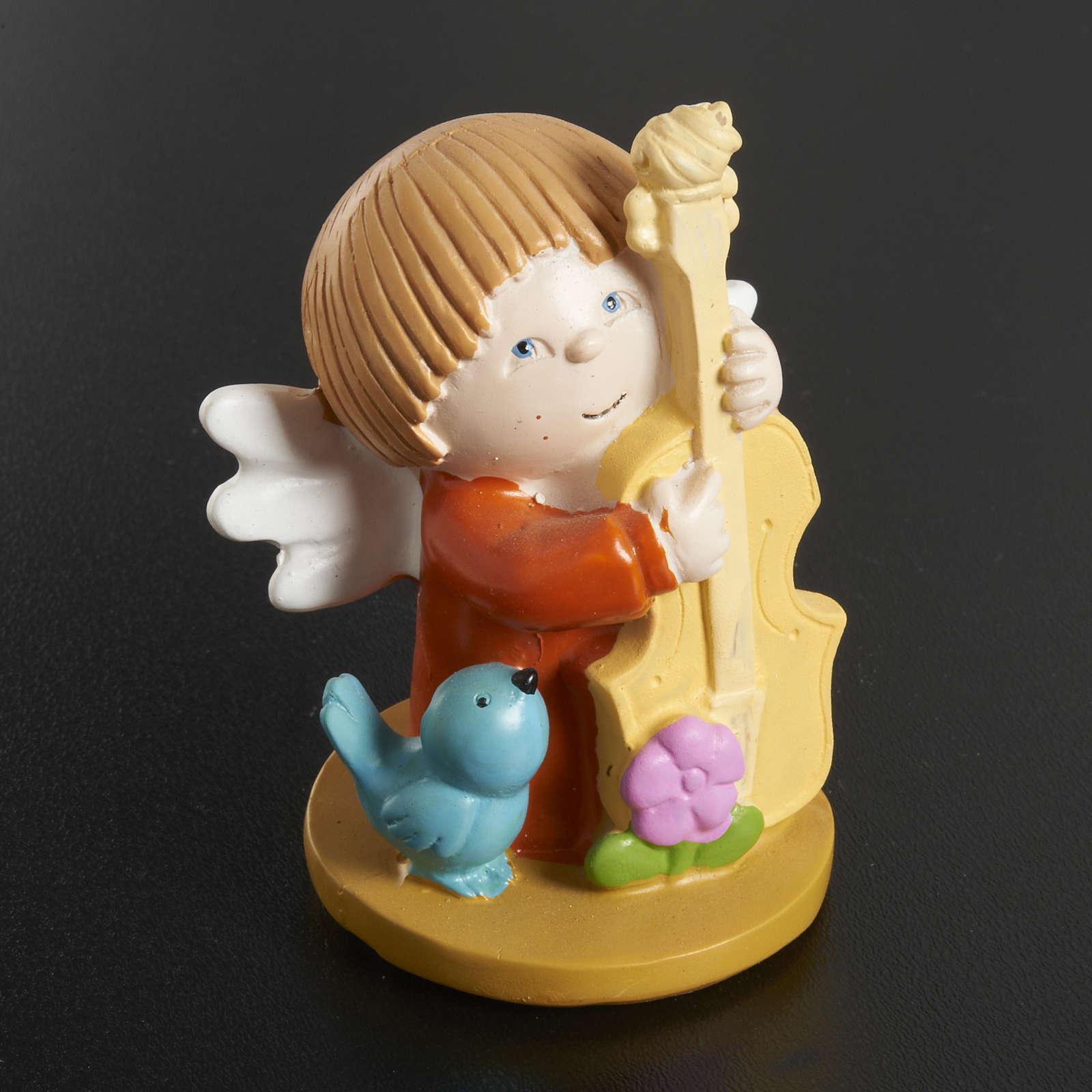 Ángeles en resina con animales e instrumentos musicales, 3