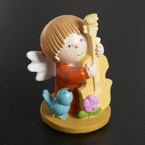 Ángeles en resina con animales e instrumentos musicales, 2