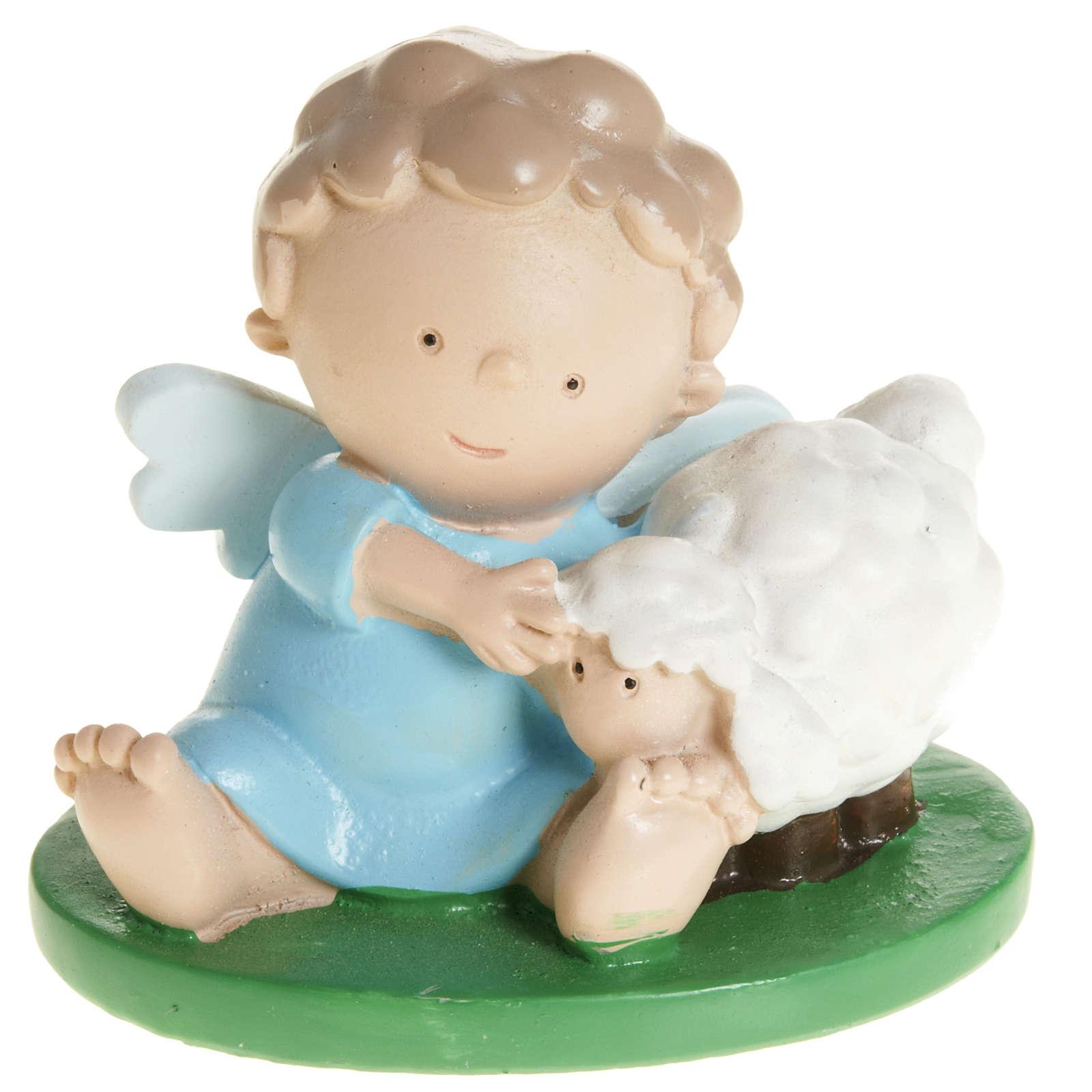 Ángel con ovejas  en resina de color 6x5 3