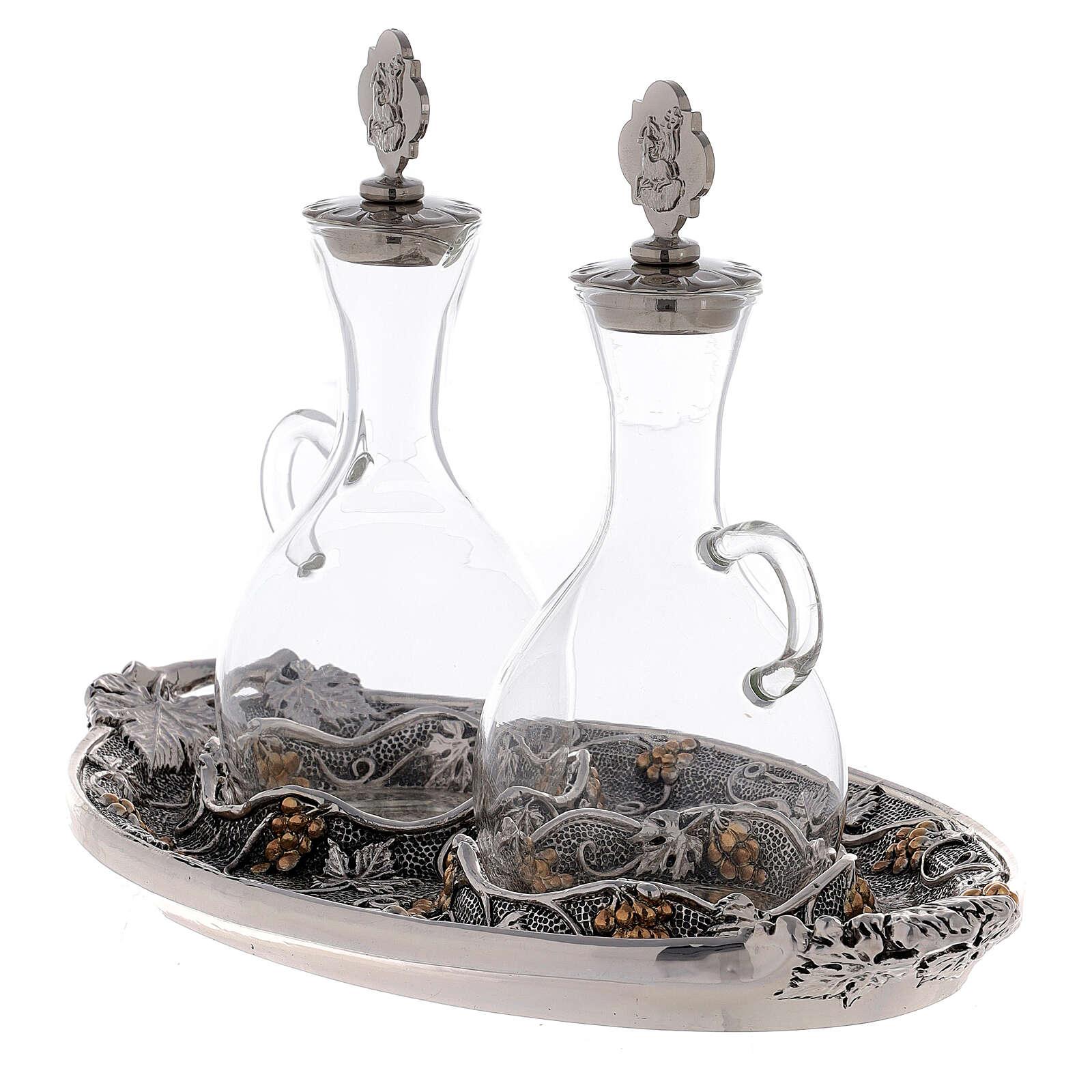Vinajeras de vidrio con bandeja plateada 4