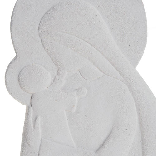 Bas-relief Virgin Mary holding the child,