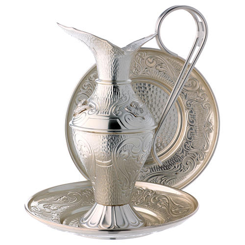 Ewer set with chiselled angels 1