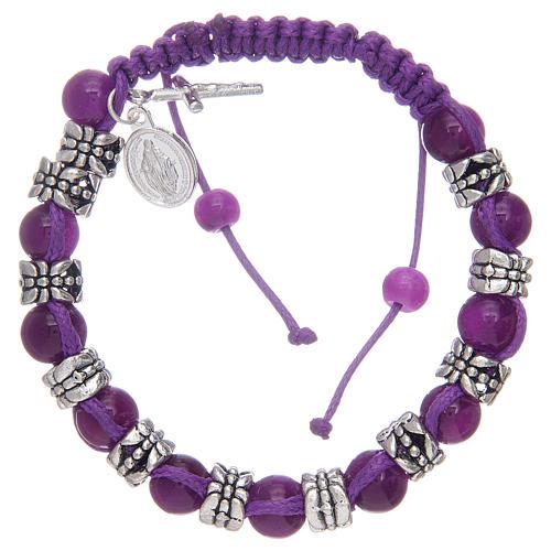 Bracelet avec grains en verre et métal sur corde coloré 1
