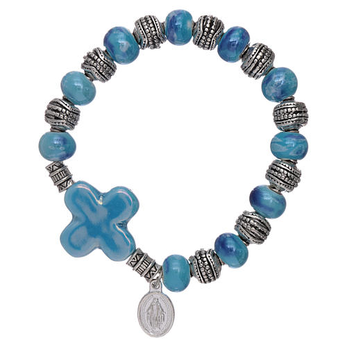 Elastic bracelet with ceramic grains 10x8 mm and light blue cross 1