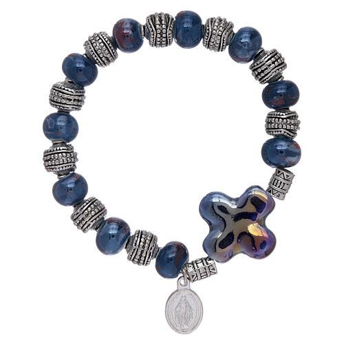 Elastic bracelet with ceramic grains 10x8 mm and blue cross 1