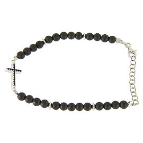 Silver bracelet with opaque hematite balls and a religious insert with a black zirconate cross s1