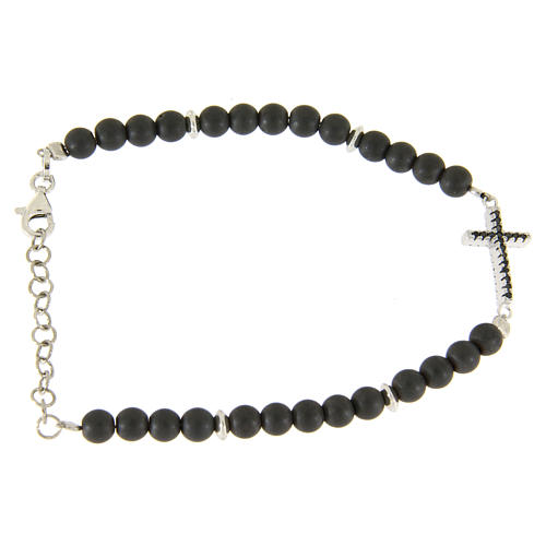 Silver bracelet with opaque hematite balls and a religious insert with a black zirconate cross 2