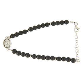 Bracelet with opaque hematite balls, details and Saint Rita medalet with white zircons s2
