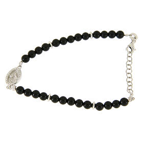 Silver bracelets: Bracelet with black onyx pearls, Saint Rita insert and white zircons