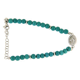 Silver bracelets: Bracelet with turquoise paste beads, Saint Rita medaley and white zircons, in 925 sterling silver
