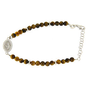 Silver bracelets: Bracelet with white zirconate medal and tiger's eye beads