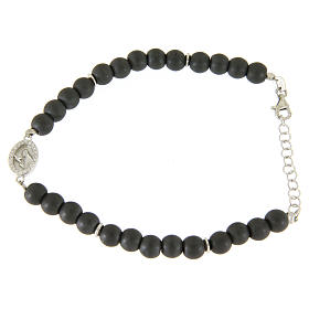 Silver bracelets:  Opaque gray hematite stone bracelet with medal of Saint Rita white zircons