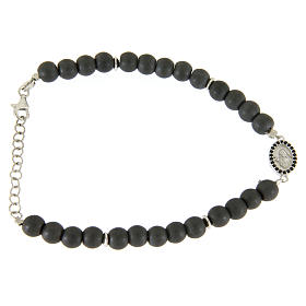 Silver bracelets:  Opaque grey stone bracelet in hematite, Saint Rita medal with black cubic zircons