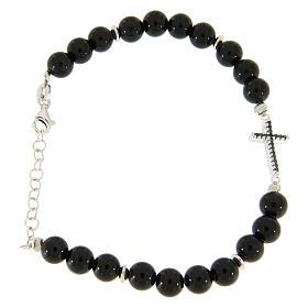 Silver bracelets:  Bracelet with onyx black balls, a silver cross and black zircons