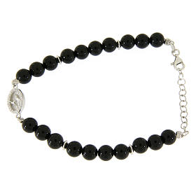 Silver bracelets:  Bracelet with white and silver zircons, Saint Rita medal and black onyx beads