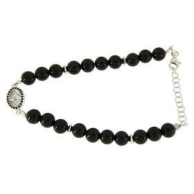 Silver bracelets: Bracelet in silver with Saint Zita medal, black zircons and black onyx beads