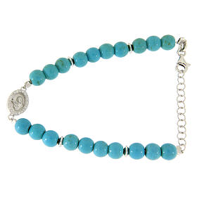 Silver bracelets: Bracelet with turquoise paste spheres and gold veins with Saint Rita medal and white zircons