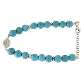 Silver bracelets: Bracelet in silver with Saint Rita medalet and white zircons, turquoise paste sized 7 mm
