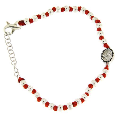 Pulsera pequeña medalla S. Rita plata y zircones negros, esferas plata 3 mm y nudos algodón rojo 1