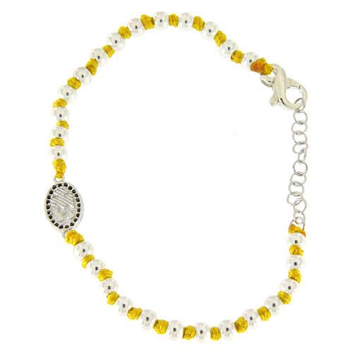 Pulsera pequeña medalla S. Rita zircones negros, esferas 3 mm de algodón amarillo con nudos 2