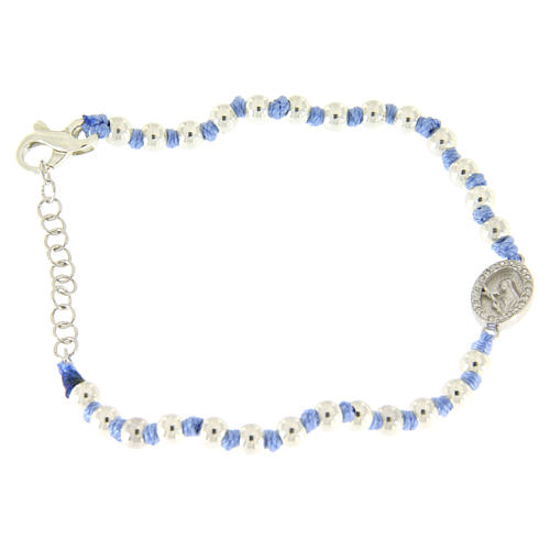 Bracelet with Saint Rita medalet in silver and white zircons, 3 mm spheres and light blue cotton knots 1