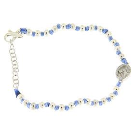 Pulsera pequeña medalla S. Rita plata y zircones blancos, esferas plata 3 mm y nudos de algodón azul s1
