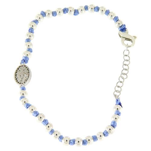 Pulsera pequeña medalla S. Rita plata y zircones blancos, esferas plata 3 mm y nudos de algodón azul 2