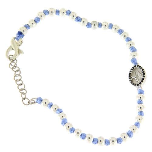 Bracciale medaglietta S. Rita argento e zirconi neri, sfere argento 3 mm inserite in cordina azzurra 1