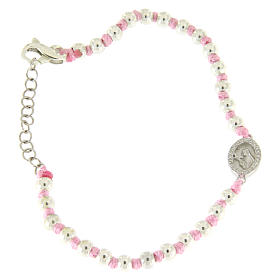 Silver bracelets: Bracelet with 3 mm silver beads, a pink cotton cord and a white zirconate Saint Rita medalet