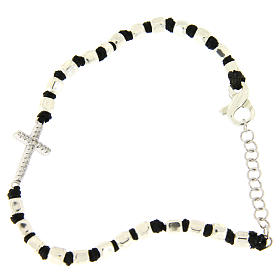 Silver bracelets: Bracelet with multifaceted silver beads sized 2 mm on a black cotton cord and a white zirconate cross