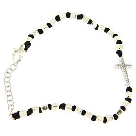 Bracelet with multifaceted silver beads sized 2 mm on a black cotton cord and a white zirconate cross s2