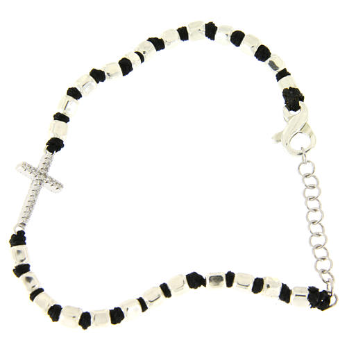 Bracelet with multifaceted silver beads sized 2 mm on a black cotton cord and a white zirconate cross 1