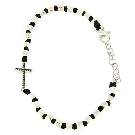 Bracelet with multifaceted silver beads sized 2 mm on a black cotton cord and a black zirconate cross s1