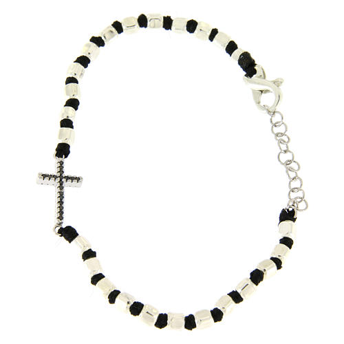 Bracelet with multifaceted silver beads sized 2 mm on a black cotton cord and a black zirconate cross 1