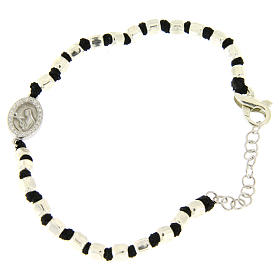Silver bracelets: Bracelet with multifaceted silver beads sized 2 mm on a black cotton cord and a black zirconate Saint Rita medalet