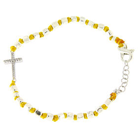 Silver bracelets: Bracelet with multifaceted spheres sized 2 mm with white zirconate cross and yellow cotton cord