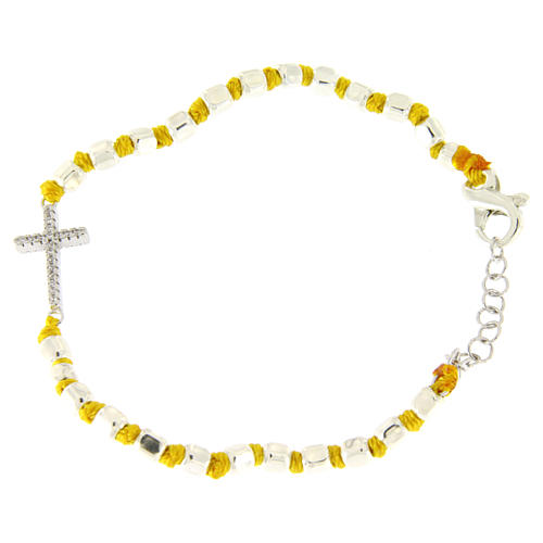Bracelet with multifaceted spheres sized 2 mm with white zirconate cross and yellow cotton cord 1