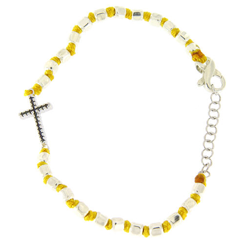 Bracelet with multifaceted spheres sized 2 mm with black zirconate cross and yellow cotton cord 2