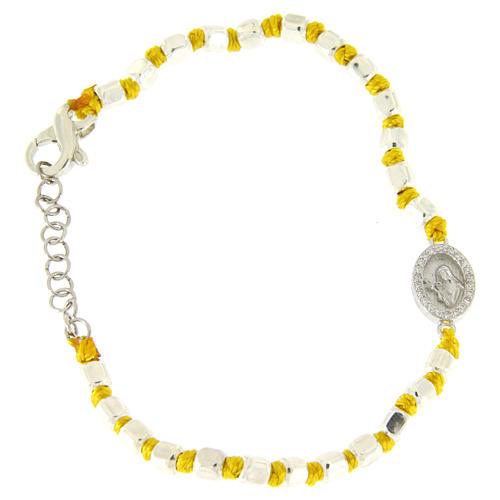 Pulsera esferas talladas plata 2 mm, nudos algodón amarillos, pequeña medalla S. Rita zircones blancos 1