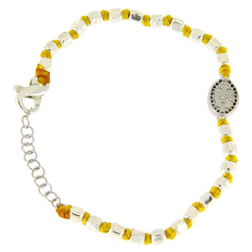 Bracelet with multifaceted spheres sized 2 mm with black zirconate Saint Rita medalet on yellow cotton cord 2