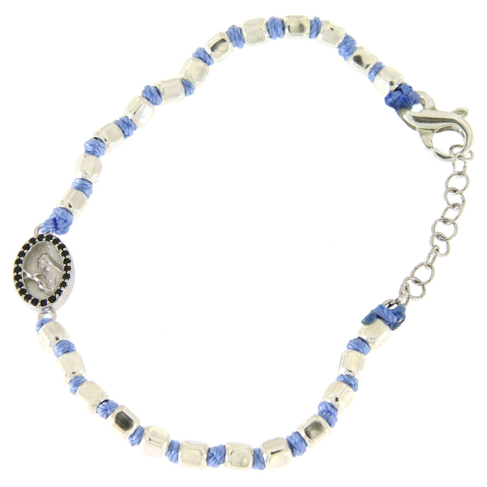 Pulsera esferas talladas plata 2 mm, cuerda con nudos azul, pequeña medalla S. Rita zircones negros 4