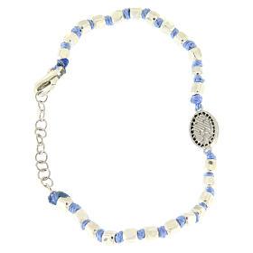 Pulsera esferas talladas plata 2 mm, cuerda con nudos azul, pequeña medalla S. Rita zircones negros s2