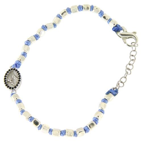 Pulsera esferas talladas plata 2 mm, cuerda con nudos azul, pequeña medalla S. Rita zircones negros 1