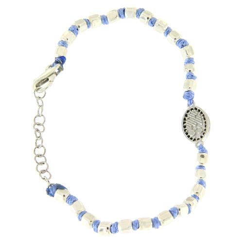 Pulsera esferas talladas plata 2 mm, cuerda con nudos azul, pequeña medalla S. Rita zircones negros 2