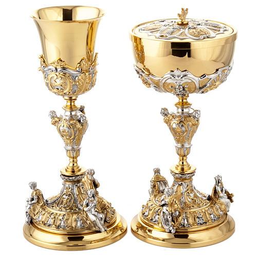 Calice argento e Pisside dorata argentata 3 putti 1