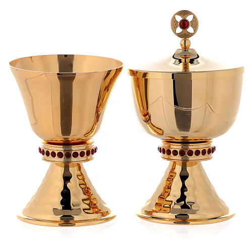 Gold plated brass chalice and ciborium with hammered base and node with red stones 1