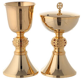 Brass chalice and ciborium with red stones on the node s1