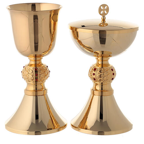 Brass chalice and ciborium with red stones on the node 1