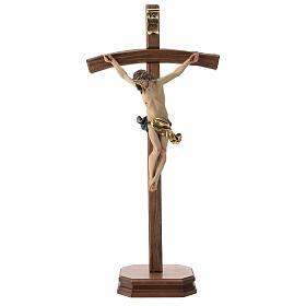 Crucifijo con base cruz curva madera Valgardena coloreada s1